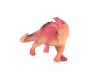 Lila plastikowa dinosaur zabawka na bielu Fotografia Royalty Free