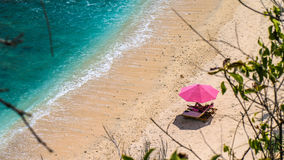 Lila Sunbed on Beautiful White Sand. Clear Blue Ocean, Atuh Beach, Nusa Penida, Bali, Indonesia.  Stock Photo