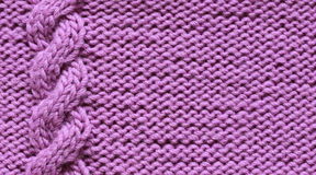 Lilac background from knitted knitted fabrics with braids , rows Royalty Free Stock Images