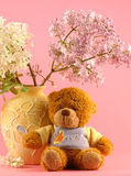 Lilac and a bear Stock Photography