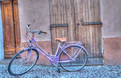 Lilac bicycle in an old, paved street Royalty Free Stock Photography