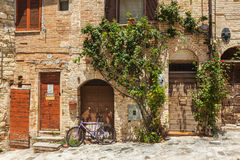 Lilac bike in the old town of Tuscany Royalty Free Stock Image