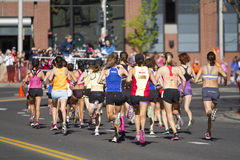 Lilac Bloomsday 2013 12k Run in Spokane WA Women's Elite Division enter the first turn Royalty Free Stock Photography