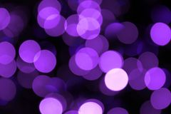 Lilac blurred lights. Blurred lilac lights holiday background Royalty Free Stock Photography