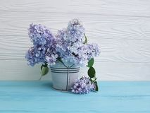 Lilac bouquet of a bucket on a wooden royalty free stock photo