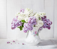 Lilac bouquet in ceramic jug. Royalty Free Stock Photos