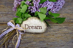 Lilac bouquet with dream on rock Royalty Free Stock Photography