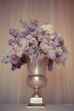 Lilac bouquet in a silver vase Stock Images