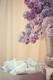 Lilac bouquet in a silver vase Royalty Free Stock Image