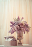 Lilac bouquet in a silver vase Royalty Free Stock Photography