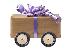 Lilac Bow Gift Box Wheel Wheels Isolated. Lilac Bow Gift Box on wheels isolated white Royalty Free Stock Photography