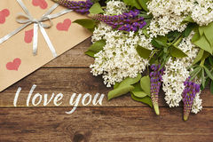 Lilac branch on wooden background, Valentine`s Day and Mothers Royalty Free Stock Photo