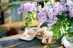Lilac and bridal shoes Royalty Free Stock Photo