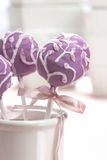Lilac cake pops lavishly decorated with icing. Royalty Free Stock Images