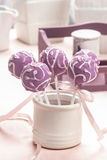 Lilac cake pops lavishly decorated with icing. Stock Image