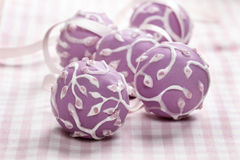 Lilac cake pops lavishly decorated with icing. Stock Photos