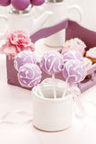 Lilac cake pops lavishly decorated with icing. Royalty Free Stock Image