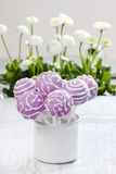 Lilac cake pops lavishly decorated with icing. Stock Photo