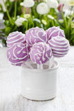 Lilac cake pops lavishly decorated with icing. Royalty Free Stock Photography