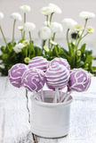 Lilac cake pops in white ceramic jar Stock Photo