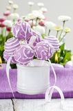 Lilac cake pops in white ceramic jar Stock Photography