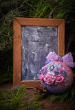 Lilac Christmas ball on fir branches. Free space for text. Blackboard. Studio photography. Object shooting Stock Image