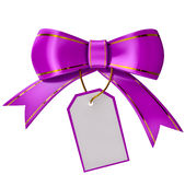 Lilac Christmas bow with label Stock Photos