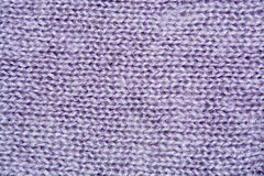 Lilac color wool knitted background closeup. Lilac color wool knitted background close up royalty free stock image