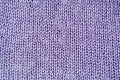 Lilac color wool knitted background closeup. Lilac color wool knitted background close up stock images