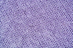 Lilac color wool knitted background closeup. Lilac color wool knitted background close up Stock Image