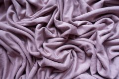 Lilac colored viscose fabric in soft folds. From above Royalty Free Stock Images