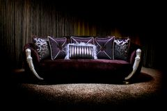 Lilac couch. Stylish vintage couch with pillows Royalty Free Stock Photo