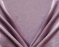 Lilac draped silk fabric Stock Photo