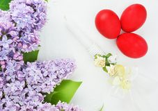 Lilac , Easter candle and red eggs Stock Image