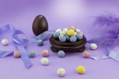 Lilac easter egg background with many speckled eggs. Conceptual Easter background Royalty Free Stock Photos