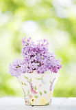 Lilac flower. On a wooden table Royalty Free Stock Photography