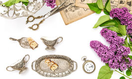 Lilac flowers, antique silver dishes. Vintage objects Stock Image