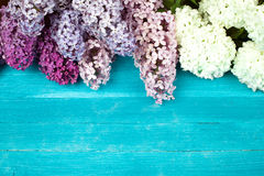 Lilac Flowers Bouquet on Wooden Plank Background Stock Photo