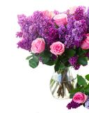 Lilac flowers. Bunch of purple Lilac flowers with pink roses in vase close up isolated on white background Stock Photo