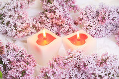 Lilac flowers and candle Royalty Free Stock Image