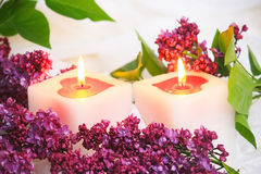 Lilac flowers and candle Royalty Free Stock Images
