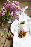 Lilac flowers and coffee Stock Image