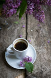 Lilac flowers and coffee Royalty Free Stock Photo
