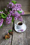 Lilac flowers and coffee Royalty Free Stock Photos