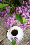 Lilac flowers and coffee Royalty Free Stock Image