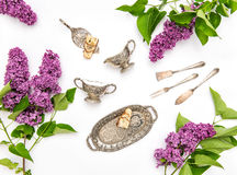 Lilac flowers. Coffee tea cake objects. Flat lay Royalty Free Stock Image