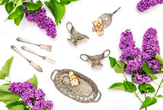 Lilac flowers. Coffee tea cake silber dishes. Flat lay Royalty Free Stock Photography