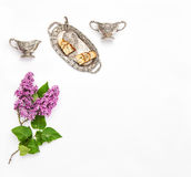 Lilac flowers Coffee tea pie silver dishes Vintage objects Royalty Free Stock Image