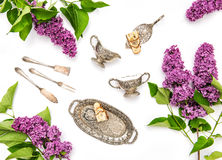 Lilac flowers. Coffee tea pie table dishes. Flat lay stock images