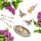 Lilac flowers. Coffee tea pie table dishes. Flat lay Royalty Free Stock Photo